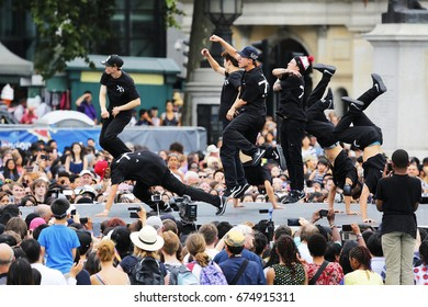 LONDON - AUGUST 9: A group of Korean hip hop dancers showing performance in the Korean Festival at Trafalgar Square, spectators present on August 9, 2015 in London, UK.