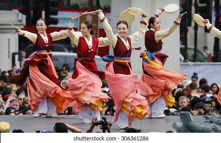 LONDON - AUGUST 9: Korean ethnic dancers perform, Hand Drum Dance, drum dance, in the Korean Festival at Trafalgar Square on August 9, 2015 in London, UK.