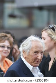 LONDON - AUGUST 9: Michael Winner greets fans as he arrives at the UK Premiere of 'The Expendables' in Leicester Square on August 9, 2010 in London