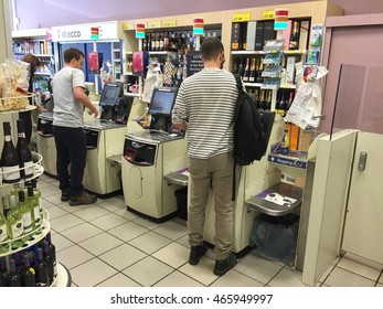 LONDON - AUGUST 9: Shoppers using self service checkouts at Tesco in Hampstead on August 9, 2016 in London, UK.