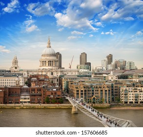 London. Beautiful aerial view of Millennium Bridge and St Paul Cathedral at sunset.