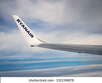 London to Berlin, Europe - March 23, 2019: The wing tip of a Ryanair Boeing aeroplane during flight above clouds