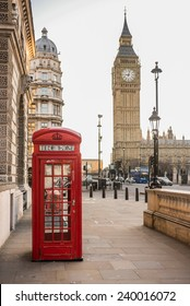 London - Big Ben tower and a red telephone booth