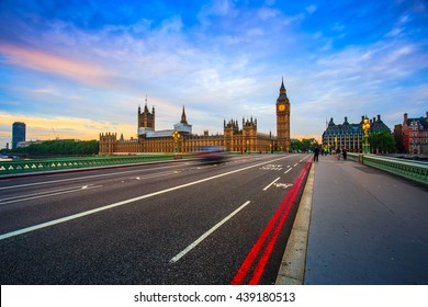 London Big Ben and traffic on Westminster Bridge in United KIngdom at sunrise in Uk.