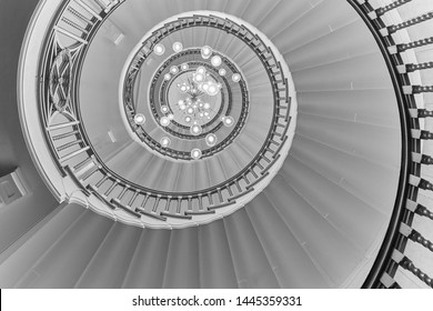 London, Bloomsbury/England - 05/01/19: The Cecil Brewer spiral staircase hypnotically whirls upward at Heal's London furniture store.