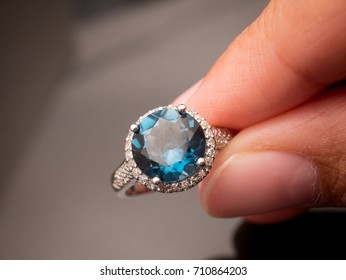 London blue topaz and Diamond Jewel or gems ring on black shine table, Collection of natural gemstones accessories