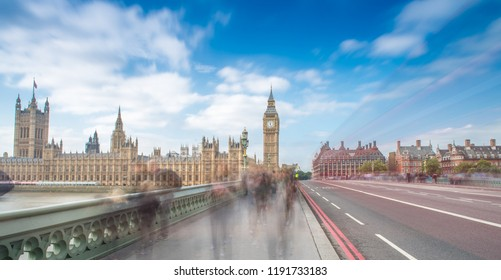 London. Blurred moving people along Westminster Bridge on a sunny day.