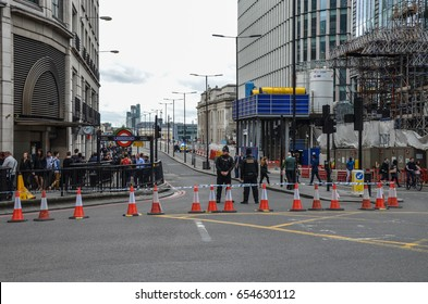 London Bridge, London - 5th June 2017 - Armed police officers stand guard at the North end of London which has been closed after the recent terror attacks only two days previously (3/06/2017)