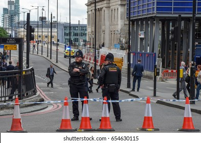 London Bridge, London - 5th June 2017 -Police officers stand guard at the North end of London which has been closed after the recent terror attacks only two days previously (3/06/2017)