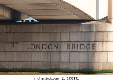 London Bridge sign under the London Bridge in London, United Kingdom