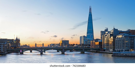 London - The bridges and the skyscraper Shard at morning dusk.