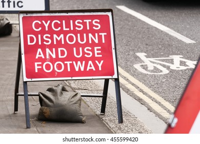 London, Britain - June 05, 2016: Cycle Lane Closed to Cyclists due to road works showing safety signs.