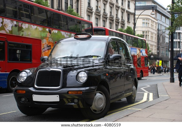 London cab abd busses on street