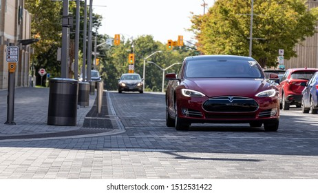 LONDON, CANADA - September 19, 2019: Tesla Model S seen in the shade on a sunny day on a brick road in urban London, Ontario.