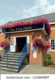 LONDON, CHADWELL HEATH/ UK- JULY 25 2018: The highly colourful floral display, that decorates the Eva hart pub in chadwell heath, London.
