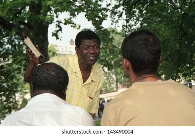 """LONDON - CIRCA JUNE 1991:An unidentified man with bible in hand expresses his religious views at """"Speakers' Corner"""" in London's Hyde Park circa June 1991, an area famous for open-air public debate."""