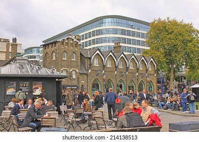 London - CIRCA OCTOBER 2011: Tower of London. People rest in a historic place on the north bank of the River Thames in central London
