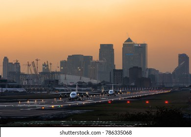 London City Airport -London / England - 05 jan. 2017: Two Avro Rj-85's are taxiing for takeoff against the backdrop of the city of London