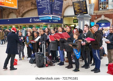 LONDON CITY - DECEMBER 23, 2016: Choir of young people singing Christmas carols on Victoria Station in December.
