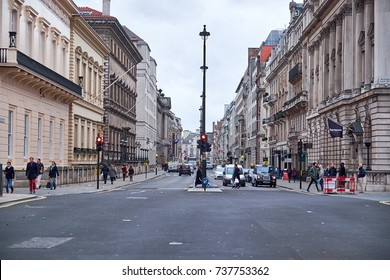 LONDON CITY - DECEMBER 23, 2016: People crossing the street where Pall Mall crosses Waterloo Place