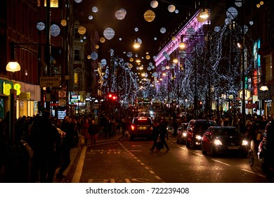 LONDON CITY - DECEMBER 24, 2016: Oxford Street with a lot of Christmas decoration hanging from wires