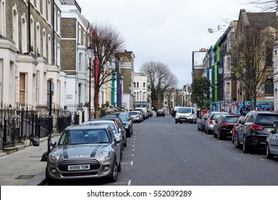 LONDON CITY - DECEMBER 25, 2016: Lancaster Road with typical freshly colored house facades near Portobello Road in Notting Hill
