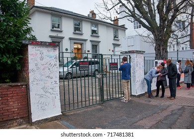 LONDON CITY - DECEMBER 25, 2016: People standing outside a secured fence at the Abbey Road Studio taking pictures