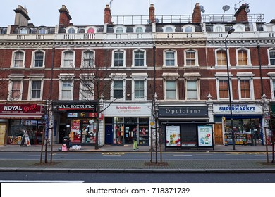 LONDON CITY - DECEMBER 25, 2016: Row of small shops in the ground floor of a row of town houses on Holland Park Avenue