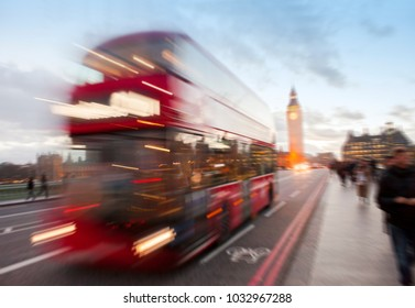 London city scene with red bus and Big Ben in background. blurred  photo