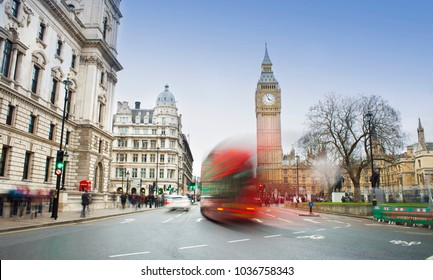 London city scene with red bus and Big Ben in background. Long exposure photo