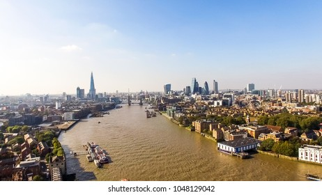 London City Skyline Aerial View feat. Famous Iconic Landmarks Skyscrapers Flying Over Thames River and Tower Bridge in England, United Kingdom 4K Ultra HD