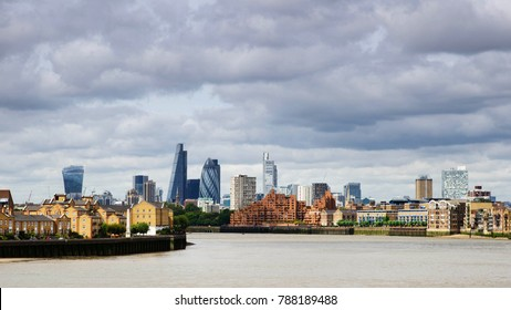 London city skyline panorama with river Thames and clouds in the sky.