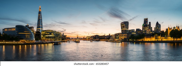 London Cityscape panorama at sunset, seen from Tower Bridge