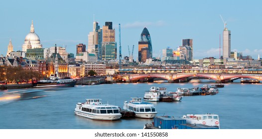 London Cityscape with St Paul's Cathedral and River Thames England UK at dusk