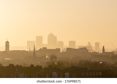 London Cityscape at Sunrise with early morning mist from Hampstead Heath looking towards Canary Wharf, England, UK