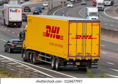 LONDON COLNEY, UK - JUNE 28, 2018: Yellow DHL lorry in motion on British motorway M25
