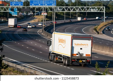 LONDON COLNEY, UK - JUNE 28, 2018: Lorry Sainsbury's in motion on the British motorway M25