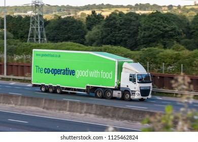 LONDON COLNEY, UK - JUNE 28, 2018: Lorry belonging to company Co-operative in motion on British motorway M25