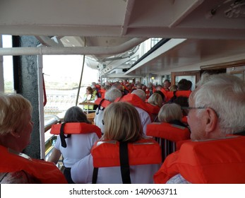 London cruise terminal, Tilbury, Essex, England, April 18th 2018. Newly boarded  passengers seen undertaking mandatory life boat drill wearing life jackets on deck of cruise ship prior to embarkation.