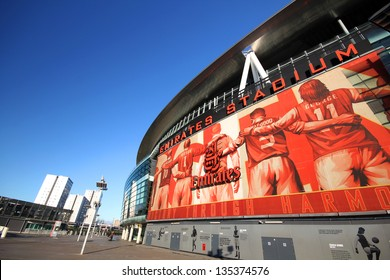 LONDON - DEC 12: Five legend players from different era are shown as a sign in front of the Emirates Stadium on Dec 12, 2012 in London, England.