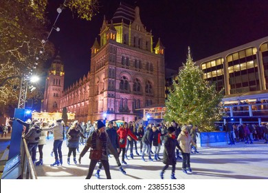 LONDON - DEC 14: National History Museum pictured on the night of December 14th, 2014. The Natural History Museum hosts a christmas tree and ice skating rink, one of the top touristic attraction.