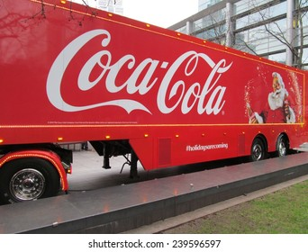 LONDON- DEC 22: The famous coca cola christmas truck, nears the end of its uk tour, with a visit to central london. LONDON, DEC 22, 2014.