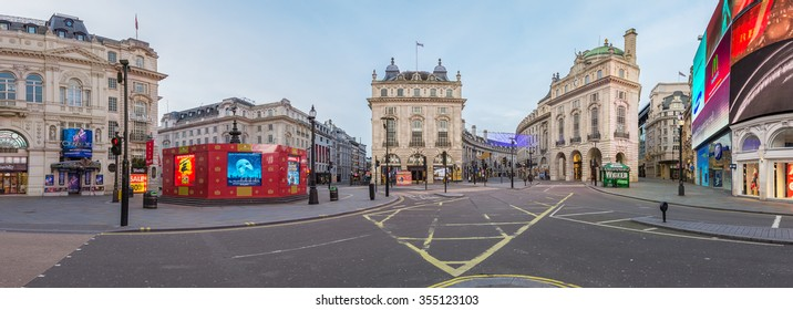 LONDON DEC 25: Empty streets, no traffic and no people on Christmas day at Piccadilly Circus Dec 25, 2015 in London, UK. Panoramic shot of the famous city centre at early Christmas morning.