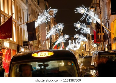 LONDON - DEC 8 : Christmas Lights Display on Bond Street on Dec 8, 2016, London, UK. The modern colorful Christmas lights attract and encourage people to the street.