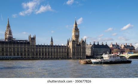 LONDON - DEC 9 : Working Boats in Front of the Houses of Parliament in London on Dec 9, 2015. Unidentified people.