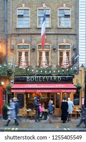 LONDON - DECEMBER 1, 2018. The Boulevard Brasserie French restaurant decorated for Christmas on Wellington Street in the Covent Garden area of London, UK.