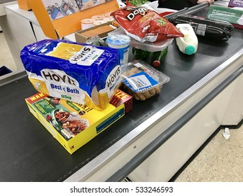 LONDON - DECEMBER 10: Groceries on the checkout conveyor belt at Sainsbury's Supermarket at The O2 Centre Finchley Road on December 10, 2016 in London, UK.