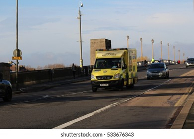 London, December 11th 2016. An ambulance operated by the London Ambulance Service travels over Wandsworth Bridge in South West London