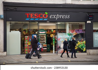 LONDON - DECEMBER 11TH: The exterior of an Tesco's express supermarket on December the 11th, 2014, in London, England, UK. Tesco's is one of the UK's leading supermarkets.