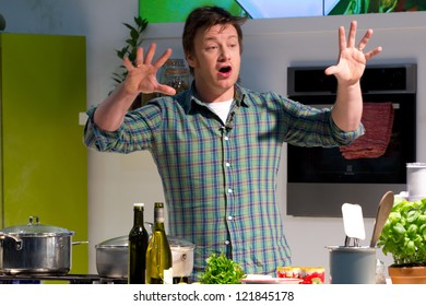 LONDON - DECEMBER 12: Jamie Oliver performs a cooking demo in London, England, on Wednesday, December 12, 2012